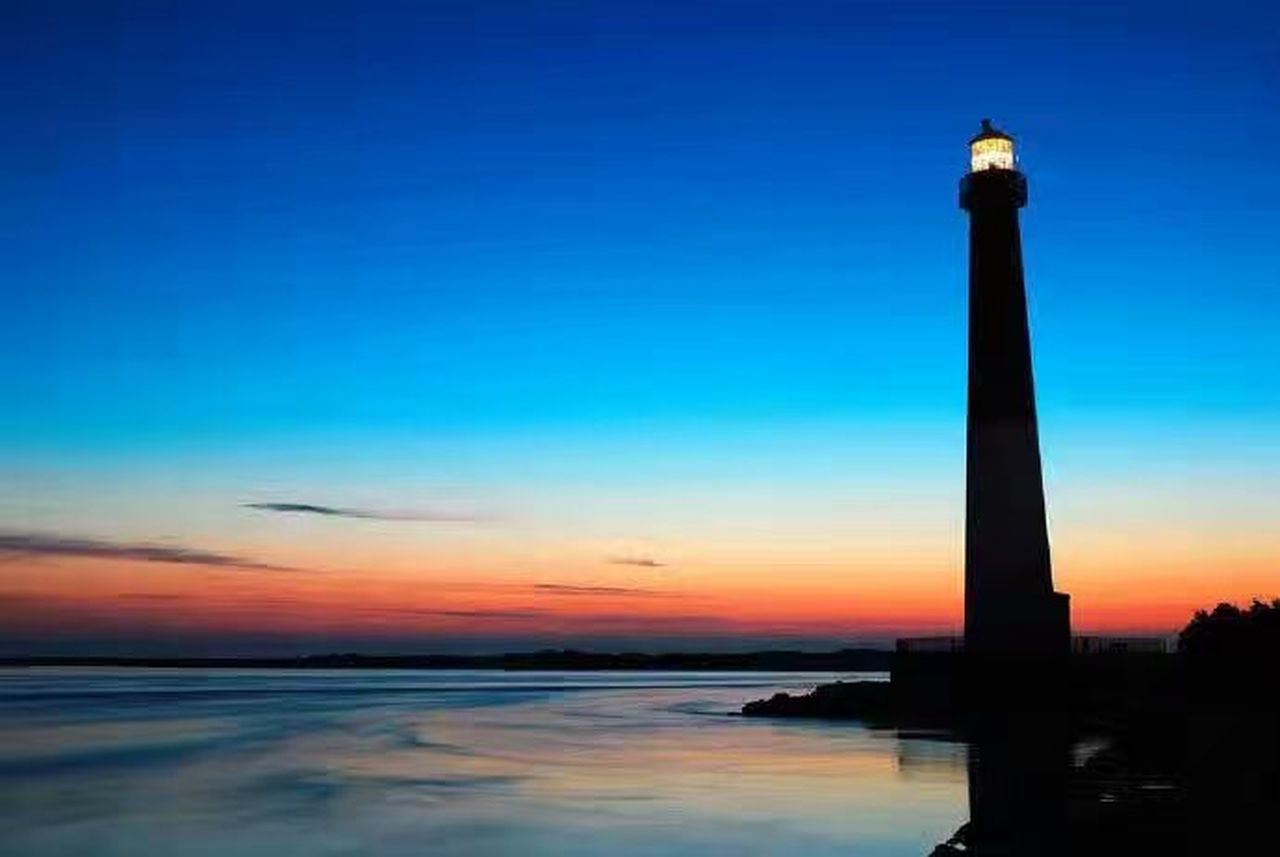 sunset, sky, travel destinations, silhouette, architecture, built structure, no people, blue, outdoors, architectural column, illuminated, sea, water, beauty in nature, nature, scenics, night