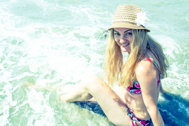 Beauty Casual Clothing Day Enjoyment Fun Leisure Activity Lifestyles Long Hair Outdoors Person Portrait Relaxation Smiling Sunglasses Sunlight Toothy Smile Vacations Water Young Adult Young Women