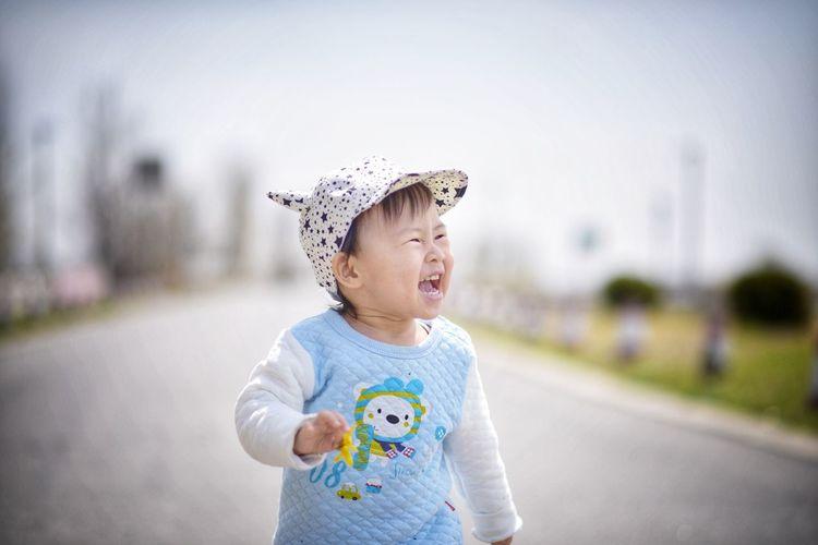 Portrait Of Cute Girl Looking Away On Road