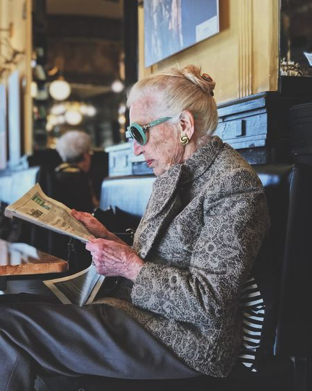 Glasses One Person Eyeglasses  Real People Sitting Indoors  The Portraitist - 2018 EyeEm Awards Lifestyles Home Interior