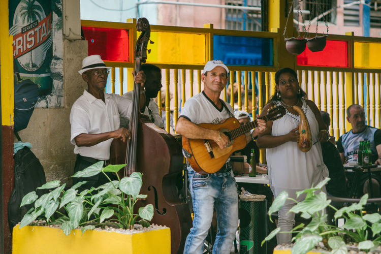 Cuba Adult Architecture Casual Clothing City Cuban Cuban Life Day Group Of People Incidental People Lifestyles Market Men Music Musical Instrument Occupation Outdoors People Real People Retail  Standing Three Quarter Length Women The Traveler - 2018 EyeEm Awards