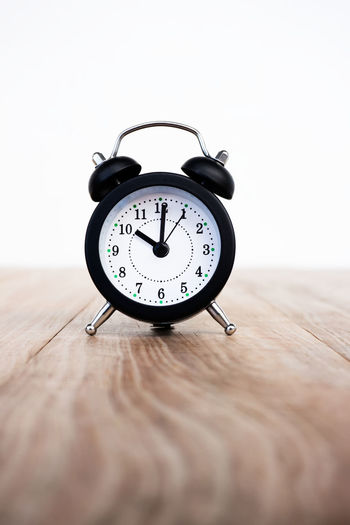 Alarm clock on wood table 10 O'clock Alarm Clock Clock Clock Face Close-up Day Indoors  No People Table Time Wood