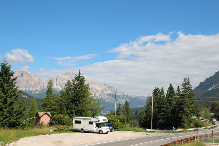 Motor Home Parked Beside ROAD PASSING THROUGH MOUNTAINS
