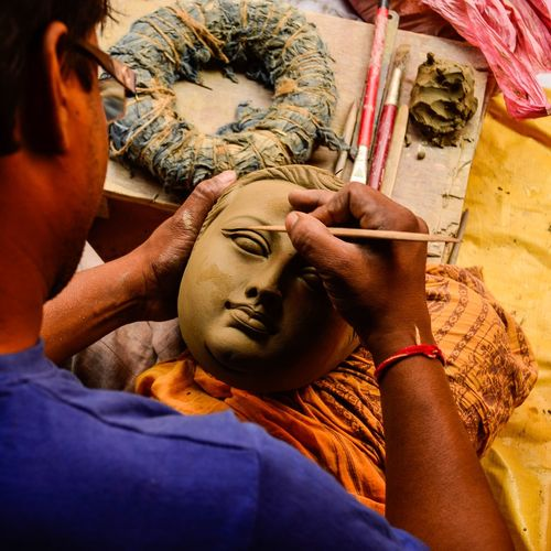 For once who created whom... an artisan working on earthen sculpture of Goddess Durga India EyeEmNewHere Artmaking Portrait Outdoors Travel Incredibleindia People Art