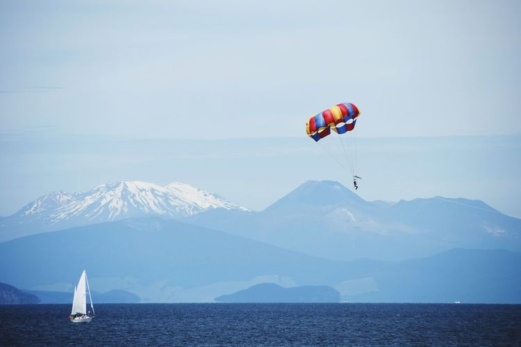 Parachute Flying Over Mountains Against Sky