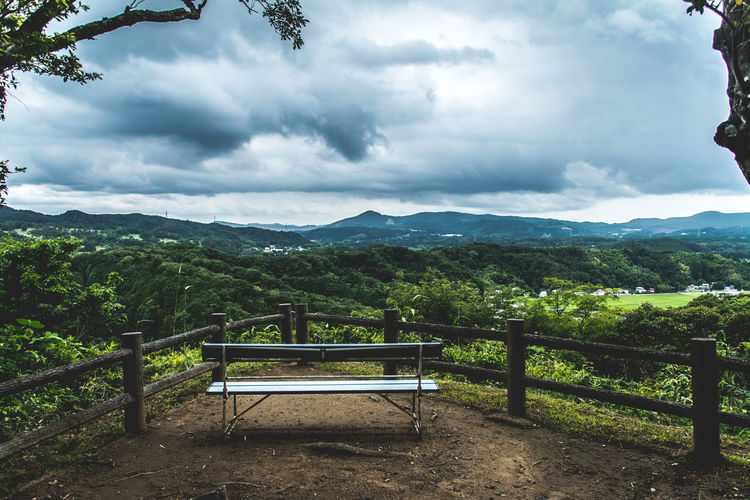 Empty Bench Overlooking Countryside Landscape