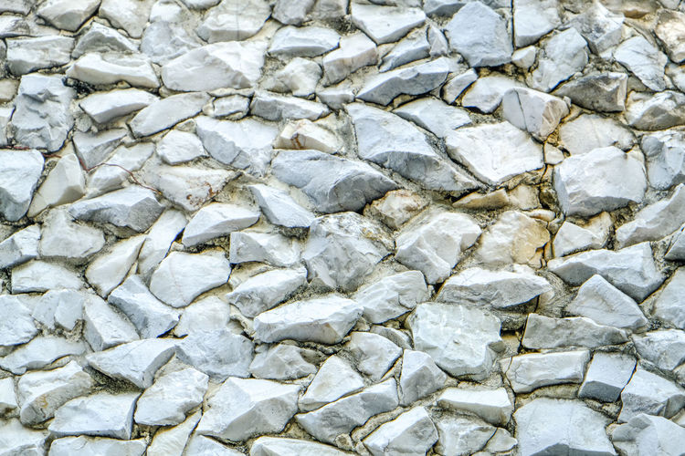 stone wall Abstract Abundance Backgrounds Clean Close-up Day Full Frame Gray Large Group Of Objects Nature No People Outdoors Pattern Pebble Quartz Rock Rock - Object Rough Solid Stone - Object Stone Material Stone Wall Textured  Textured Effect White Color
