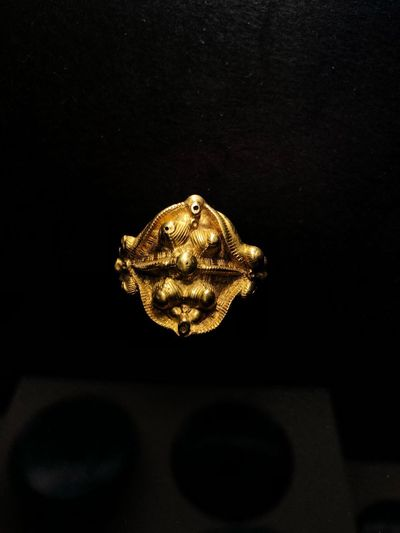 Celtic ring, 2000 years old No People Black Background Indoors  Close-up Illuminated Copy Space Animal Wildlife Gold Colored Decoration Lighting Equipment Animal Themes Representation Christmas Metal Animal Representation Studio Shot Night Animal Dark Holiday