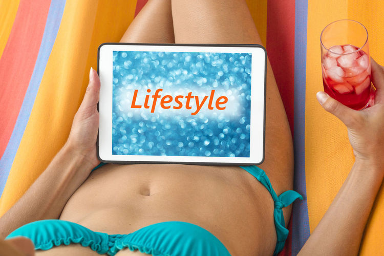 Midsection Of Bikini Woman With Drink Showing Message On Digital Tablet