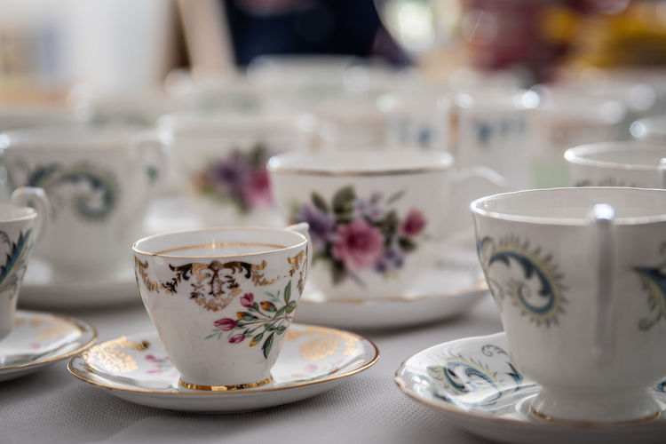 Cups and saucers Ceramics Coffee Coffee - Drink Coffee Cup Crockery Cup Drink Floral Pattern Focus On Foreground Food And Drink Freshness Hot Drink Indoors  Mug No People Refreshment Saucer Still Life Table Tea Tea - Hot Drink Tea Cup Temptation