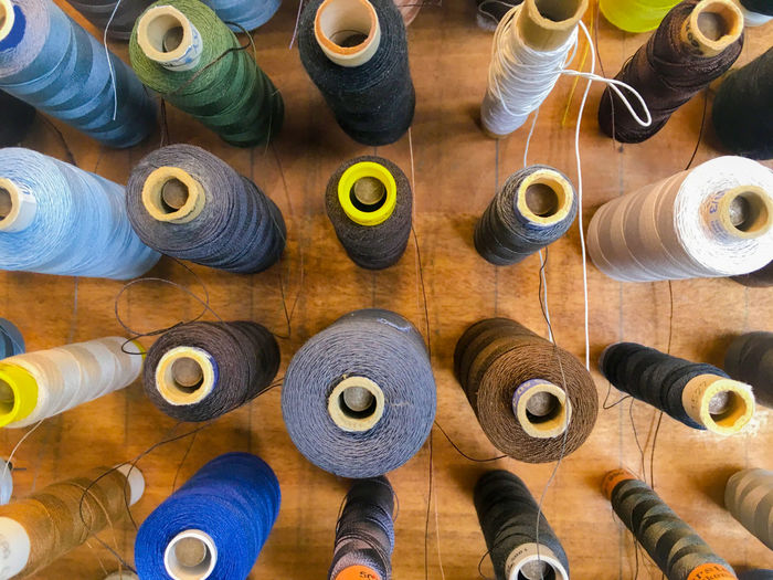 Directly Above Shot Of Colorful Spools Arranged On Table