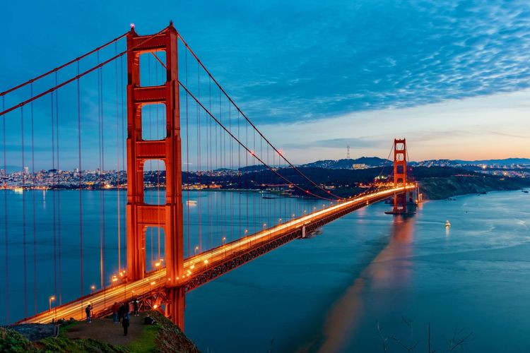 Built Structure Transportation Bridge Connection Bridge - Man Made Structure Architecture Sky Water Suspension Bridge Travel Destinations Engineering Cloud - Sky Illuminated Nature Bay Of Water Bay Tourism City Travel Outdoors