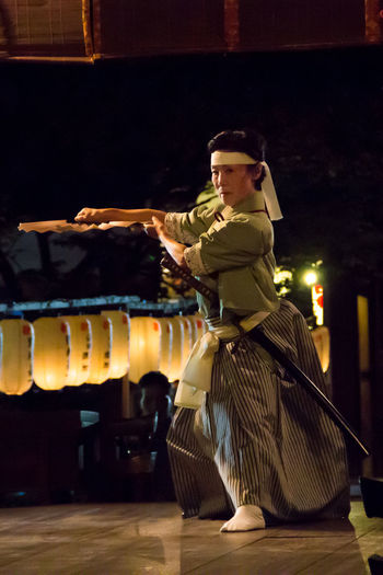 This is a picture of a lantern festival at Hirano shrine in Kyoto. During this festival there were several traditional performances like noh and dancing. The woman in this picture was performing a dance using a katana and a fan. I must say that this festival is a great oportunity to enjoy the traditional part of Japan, and there weren't many people so if you are planning on taking some pictures, this is a good time to do so. Enjoy! Cultures Dance Festival Hirano Japan Kat Kyoto Lantern Manto Shinto Shrine Shrine Travel Travel Photography Traveling