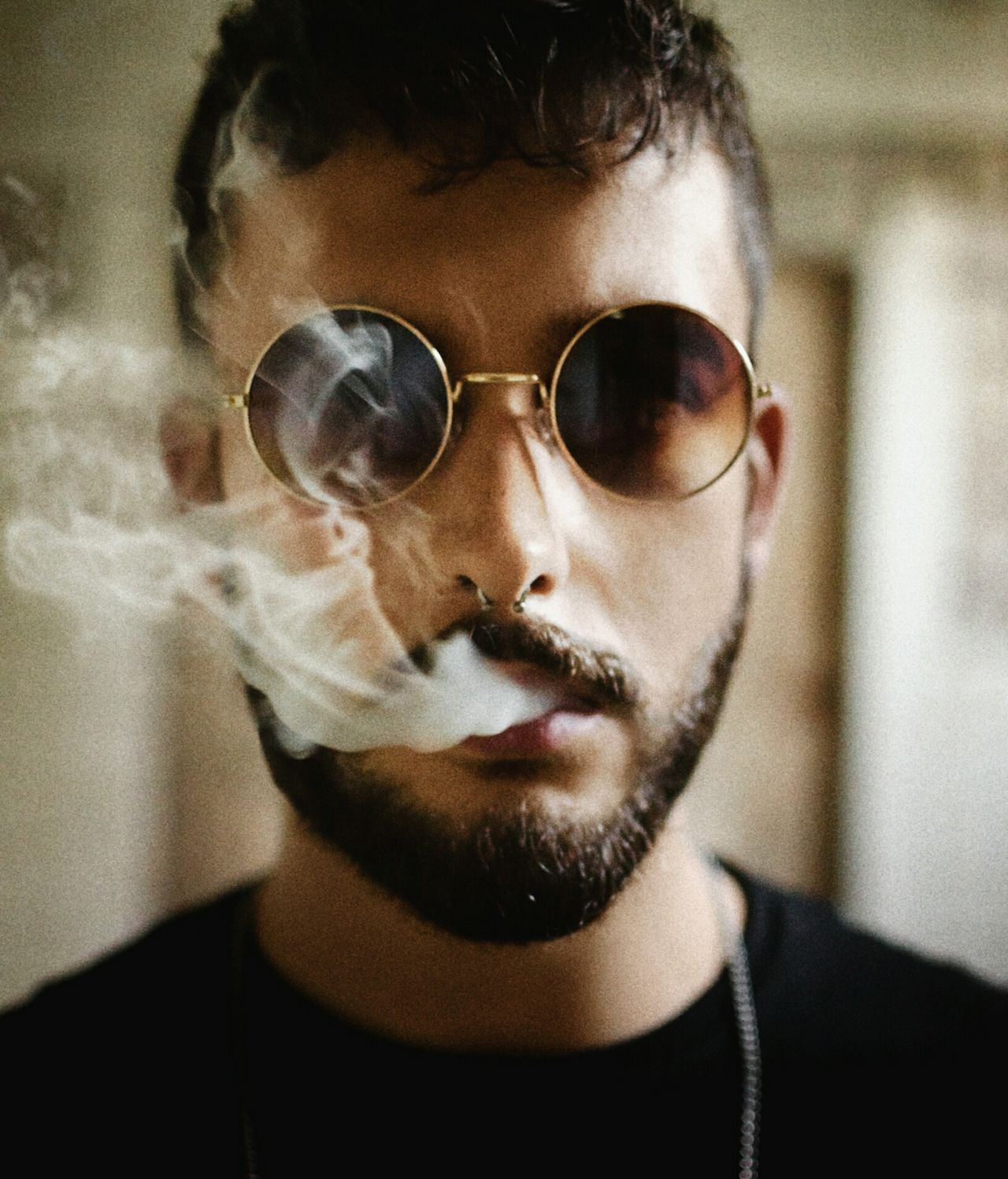 Close-up portrait of young man smoking