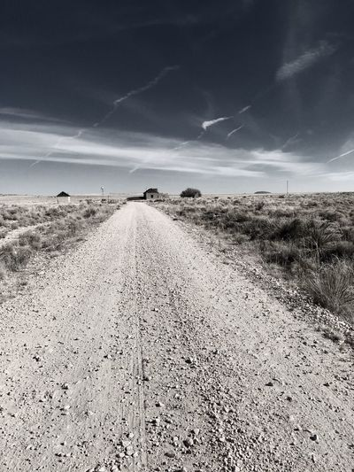 """Mystery Ranch"" No. 4 in series. The Long Road In. Abandoned Places Abandoned New Mexico Photography New Mexico Perspective Dirt Road Roads Sky The Way Forward Landscape Nature Cloud - Sky Road Outdoors Scenics"