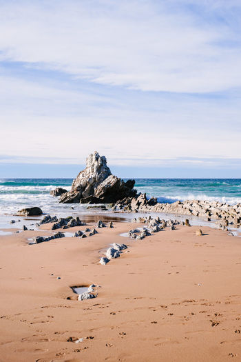 Lonely rock and Atlantic Ocean Atlantic Ocean Beach Beauty In Nature Cloud - Sky Horizon Horizon Over Water Land Nature No People Rock Rock - Object Rock Formation Sand Scenics - Nature Sea Sky Solid Tranquil Scene Tranquility Water Rock Wave Travel Destinations