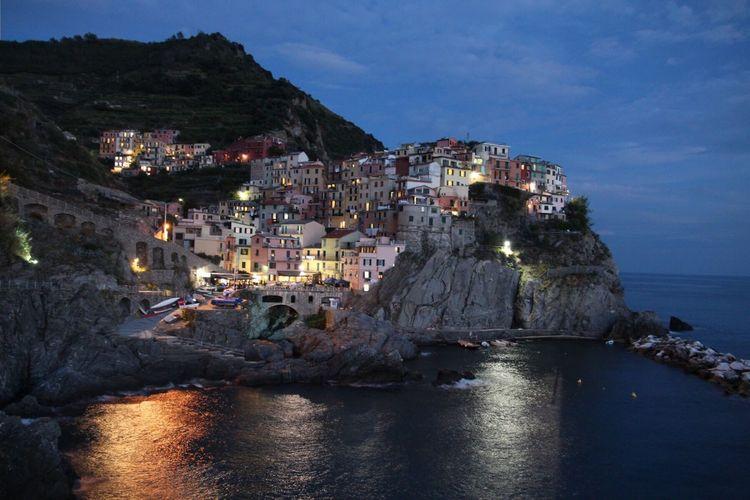 Cinque Terre Liguria Italy Village Manarola Houses Hilltop Cliff Ocean Pastels Dusk Travel Photography Urban Landscape Urban Picturesque Reflections By Night