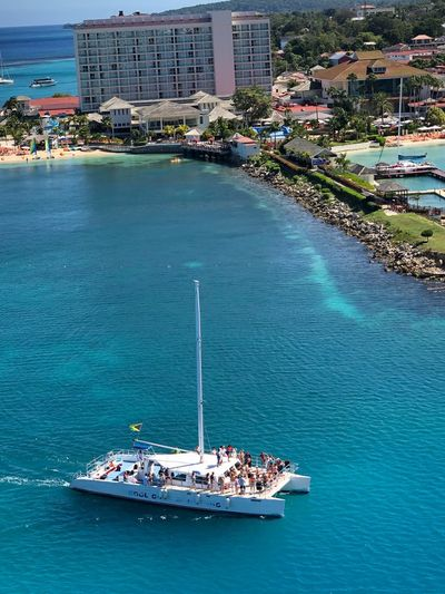 High angle view of people on yacht in sea