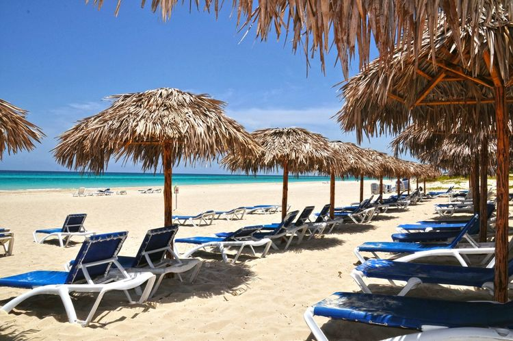 Varadero Cuba Varadero Varadero, Cuba Cuba Cuba. Varadero Cuban Beach Hollyday Beach Day Beach Time Beach Holiday Paradise Beach Relaxing Moments Relaxing Place Blue Sky Blue Sea Blue Water Sandy Beach Idyllic Water Sea Beach Sand Summer Blue Thatched Roof Outdoor Chair Chair Relaxation Beach Umbrella Lounge Chair Resort