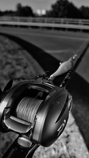 Rod Reel Baitcast Fish Fishing Lake Water River Blackandwhite B/W Photography Lure Hobbies Holiday Hunting Hanging Out Daiwa Bass EyeEm Selects Human Hand Close-up