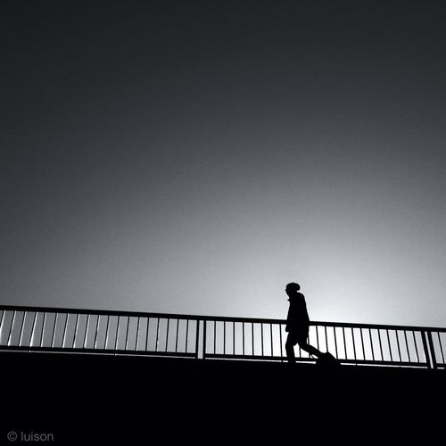 Woman standing by railing