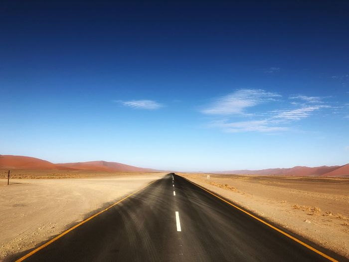 Follow the road Namibia Landscape Sand Dunes, Death Valley Namibia Sky The Way Forward Direction Road Transportation Blue Nature Diminishing Perspective Scenics - Nature Landscape Road Marking Environment Desert Marking Non-urban Scene Land Tranquility
