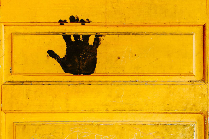 Close-up of black print on yellow door