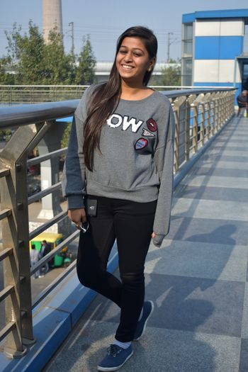 EyeEm Best Shots EyeEm Gallery EyeEmNewHere One Person White City Girl Taking Photos One Woman Only Brown Hair Smile Portrait Full Length Smiling Looking At Camera Women Standing Young Women Responsibility Confidence  Politics And Government Bridge - Man Made Structure Lighthouse Suspension Bridge Underneath