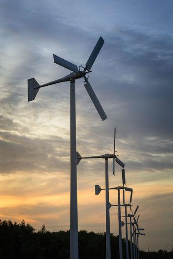 Wind generators turbines on sunset summer landscape Alternative Energy Background Cloud - Sky Day Energy Natural Energy Nature No People Outdoors Sky Sunset Wind Generator Wind Mill Wind Power Wind Power Unit Wind Turbine Wind Turbines Wind Wheel