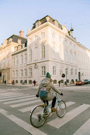 Bicycles parked on road against buildings in city