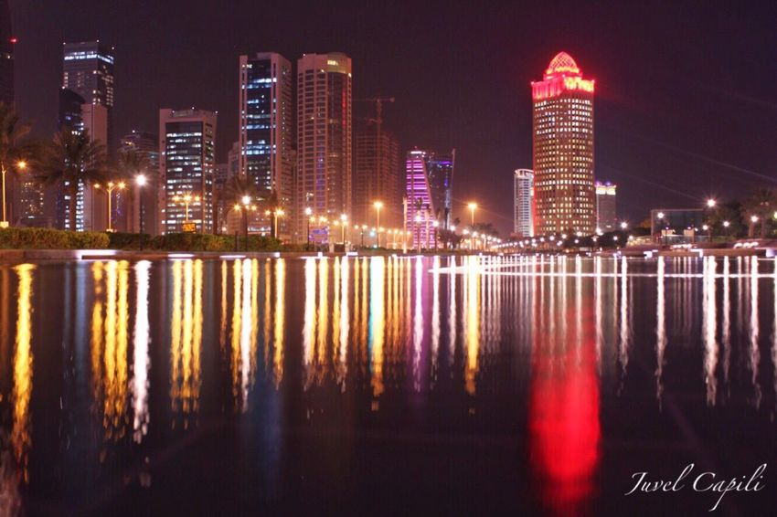 Illuminated Architecture Building Exterior Built Structure Reflection Night Water Skyscraper City Modern Waterfront Outdoors Travel Destinations Sky Urban Skyline Cityscape