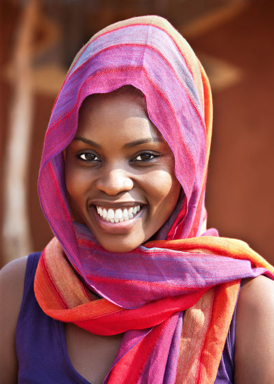 Beautiful Woman Cheerful Close-up Day Focus On Foreground Front View Happiness Headshot Human Face Leisure Activity Lifestyles Looking At Camera One Person Outdoors Portrait Real People Red Smiling Toothy Smile Traditional Clothing Young Adult Young Women
