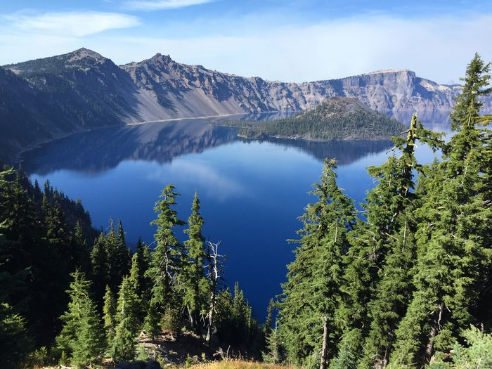 Scenic View Of Wizard Island In Crater Lake Against Sky