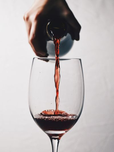 Pouring red win into a glass Food And Drink Close-up Drink Refreshment Motion Splashing No People Freshness Wineglass White Background Drinking Glass Indoors  Wine Winery Red Wine Alcohol Alcoholic Drink Liquor Liquid Pouring Wine Pouring Drinks Cabernet Wine Moments