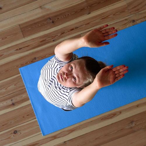 High angle view of baby lying on floor