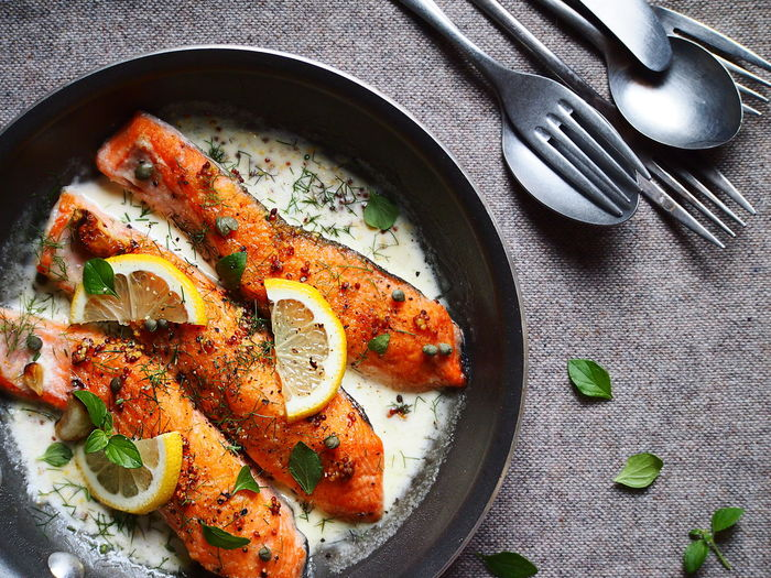 Crispy Edge Salmon in Creamy Lemon & Dill Sauce Close-up Directly Above Focus On Foreground Food Food And Drink Frying Pan Healthy Eating High Angle View Lemon On The Table Salmon Still Life Table
