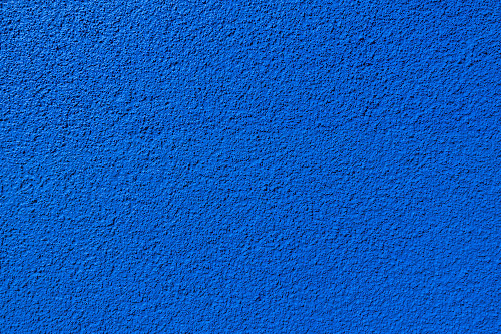 Detail of a blue wall texture made of granular rough plaster Copy Space Paint Painted Textured  Wall Abstract Architectural Detail Background Blue Coarse Color Colour Copyspace Granular Pattern Patterned Plain Plaster Plasterwork Rough Roughcast Structure Texture Uneven Unicolor