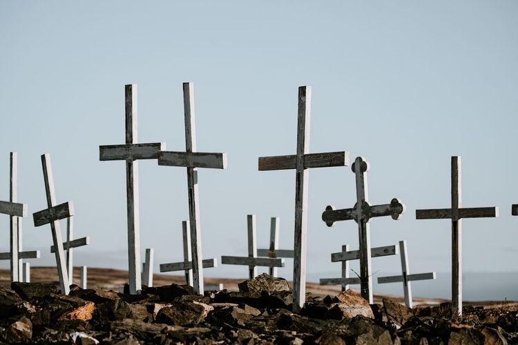 Cross on field against clear sky