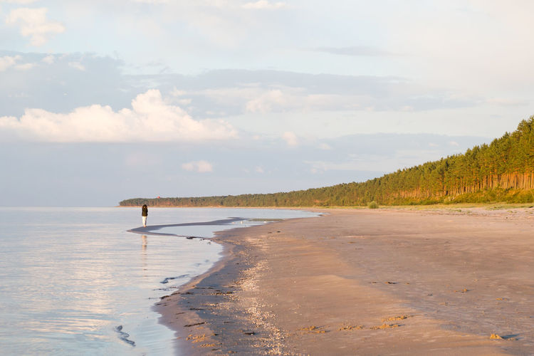 Beach Beauty In Nature Cloud Cloud - Sky Coastline Day Distant Idyllic In The Distance Life At The Beach Nature Non-urban Scene Outdoors Remote Sand Scenics Shore Sky Tranquil Scene Tranquility Water White Dress Woman