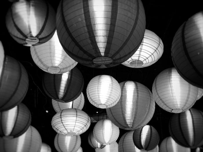 Low angle view of illuminated lanterns hanging from ceiling