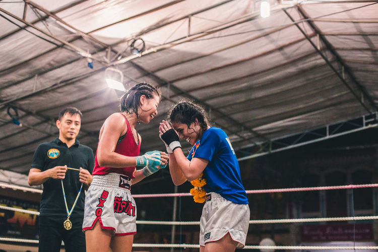 Respect for the victor. International Women's Day 2019 Athlete Healthy Lifestyle Vitality Young Women Women Sportswoman Respect Muay Thai Martial Arts Winner Victory Joy Happiness Friendship