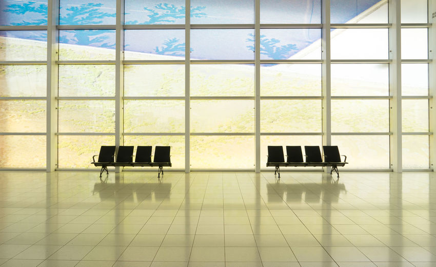 Digital composite image of empty chairs in building