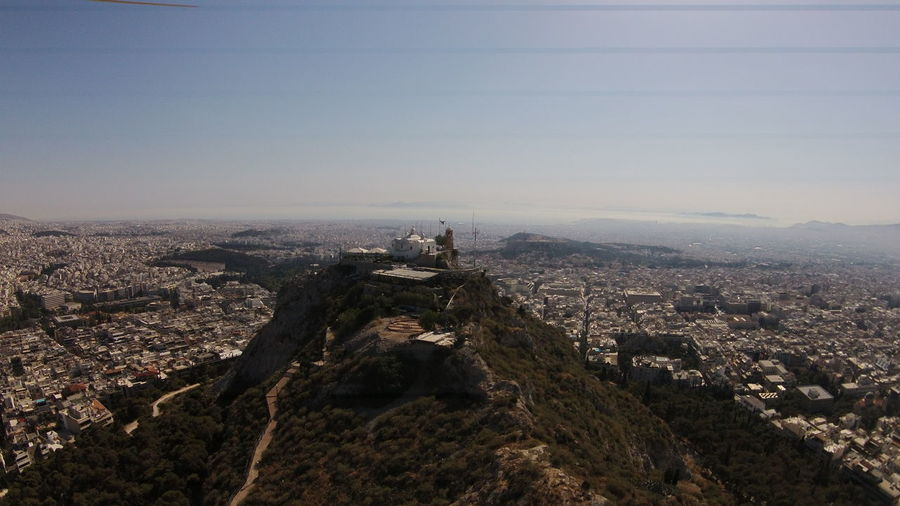 Aerial view of mount lycabettus by residential district against sky