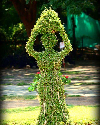 A girl posing for photo Girl Beautiful Girl Beautiful Garden Statue Tree