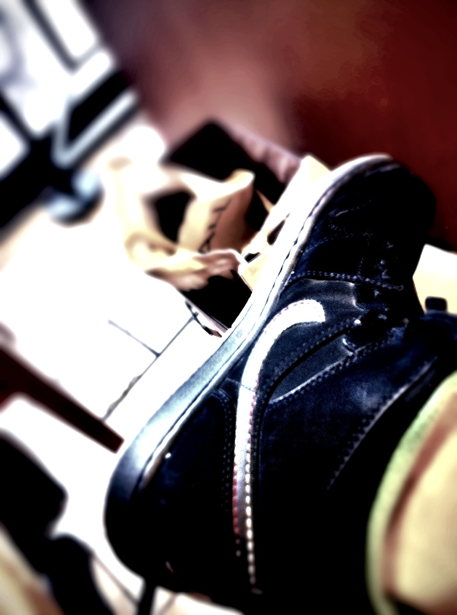 indoors, shoe, close-up, selective focus, focus on foreground, still life, footwear, music, low section, metal, high angle view, person, black color, no people, part of, day, sunlight, fashion, technology, musical instrument