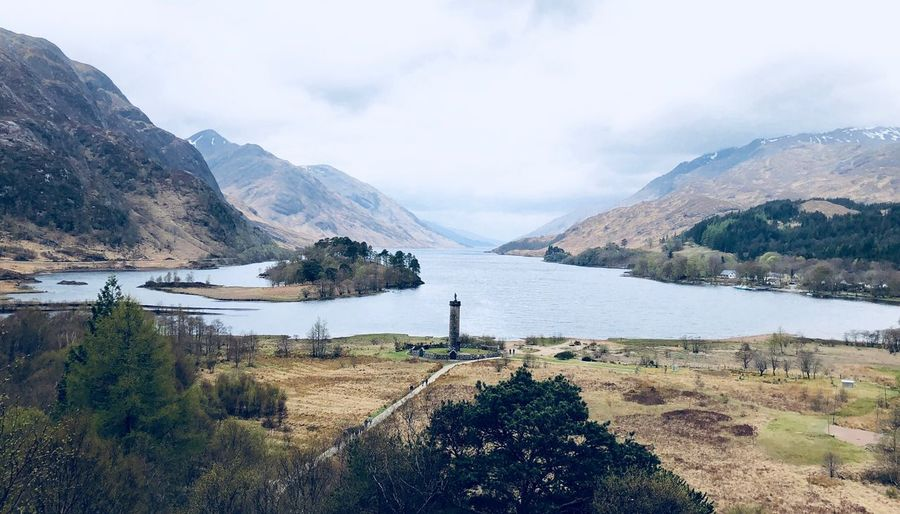 Glenfinnan monument at the head of Loch Shiel, Scotland Monument Highlands Scotland Mountain Water Sky Scenics - Nature Beauty In Nature Mountain Range Lake