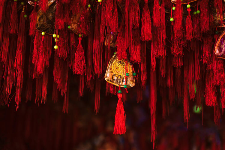 Blessing, wishing, Chinese culture China Landscape Blessing Wishing Chinese Culture Hanging Red Tassel No People Decoration Textile Art And Craft Close-up Indoors  Pattern Focus On Foreground Rope Low Angle View Night