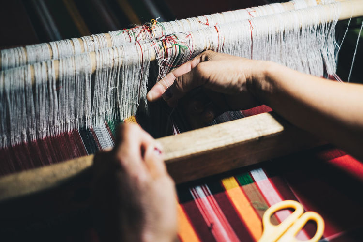 Artisan manually hand woven a cloth Thread Indoors  Real People Human Hand Human Body Part One Person Hand Loom Selective Focus Textile Weaving Textile Industry Working Art And Craft Close-up Occupation Skill  Unrecognizable Person Textile Factory Finger Backgrounds Pattern Ethnic B'laan Tribe Red Color Autumn Mood This Is Natural Beauty The Modern Professional A New Perspective On Life Holiday Moments Human Connection Capture Tomorrow It's About The Journey Humanity Meets Technology International Women's Day 2019 Streetwise Photography