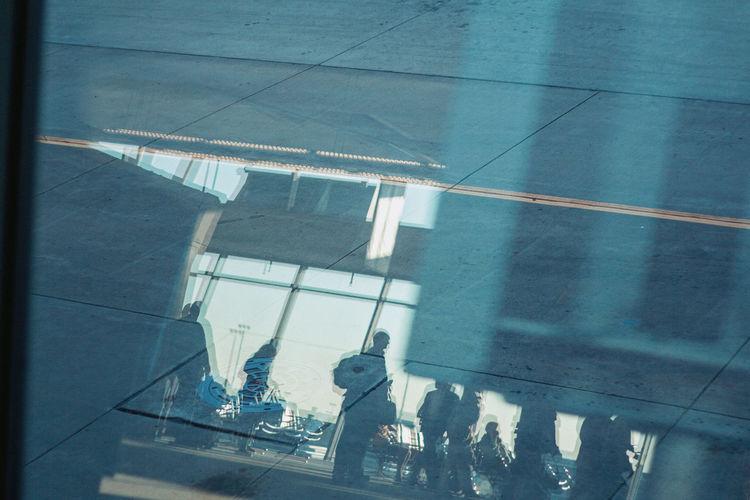 High angle view of people walking on glass window