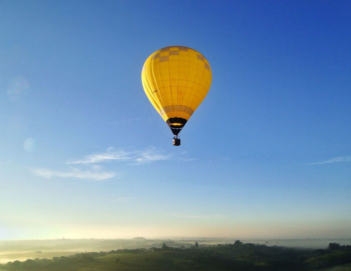 Hot Air Balloon Mid-air Flying Adventure Air Vehicle Sky Wind Cloud - Sky Blue Transportation Flame Parachute Outdoors Day Sport Ballooning Festival Aerospace Industry Nature No People Nature Balonismo Earth